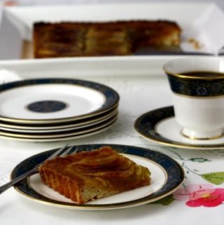 tart aux pommes on a plate with coffee
