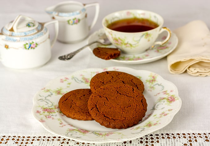 cinnamon snap cookies and tea on antique china