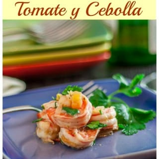 Shrimp tapas (gambas) with tomatoes and onions is a simple Spanish tapas dish that can be eaten with warm crusty bread or atop rice or pasta. Simply wonderful.