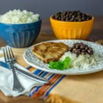 Latin American pork chops with black beans and rice