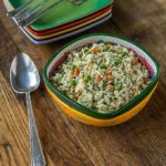 Arroz con pollo: Rice with chicken Latin American style with recaito, carrots, peas and onions. | ethnicspoon.com