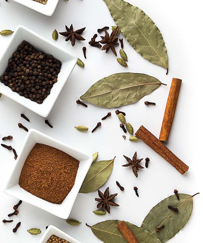 spices in dishes on a white table