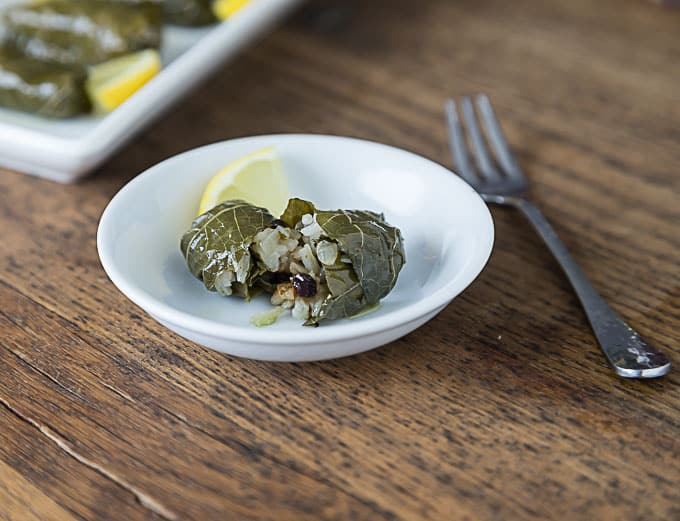 Dolmades recipe with rice, onions, currants and parsley. | ethnicspoon.com