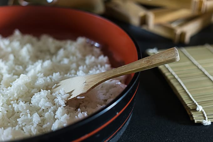 sticky rice for making sushi and a paddle in a bowl