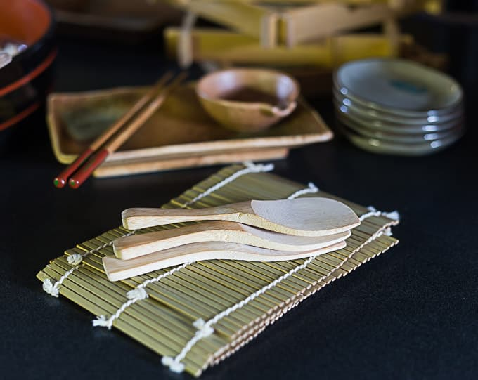 sushi rice paddles and two bamboo mats