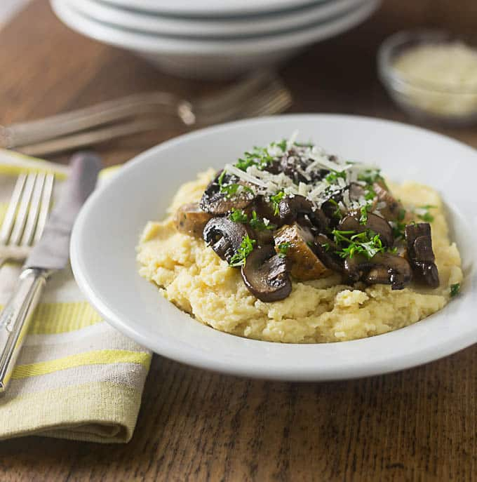 Cheesey polenta with sausages and mushrooms. | ethnicspoon.com