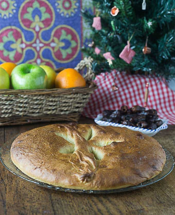 a closeup of French olive oil bread with a Christmas tree in the back