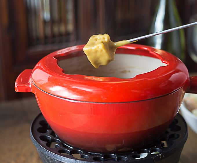 "A super simple fondue with cheddar and Guinness! A rich an hearty ""stout"" dip that is a real crowd pleaser! 