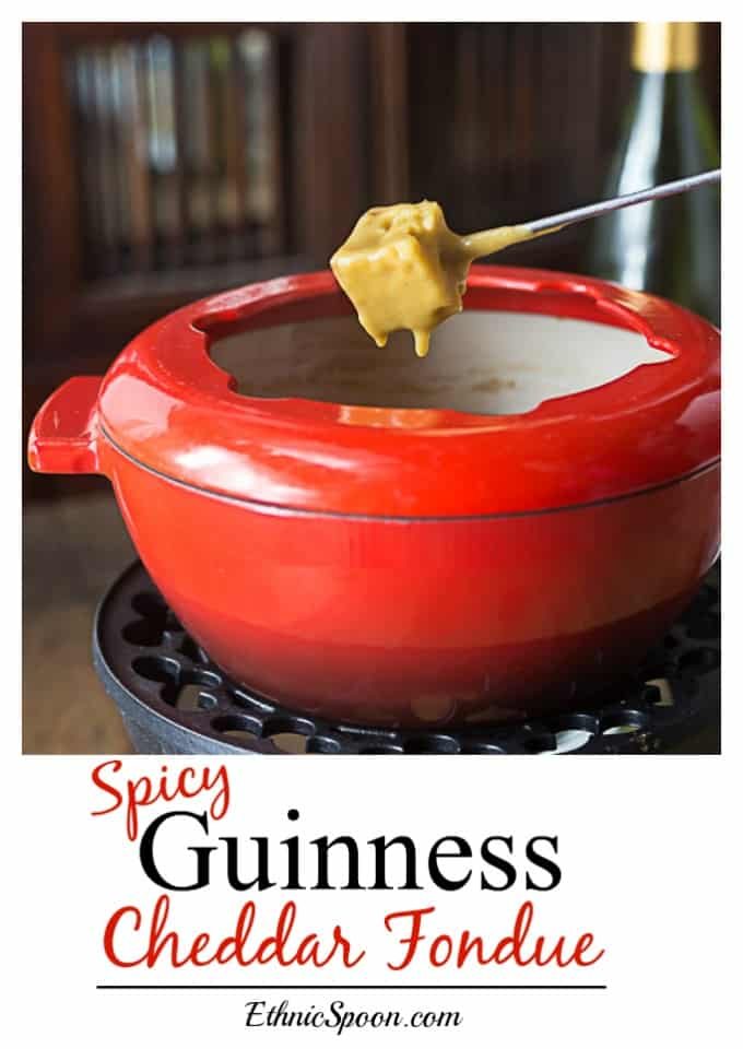 Easy cheesy Guinness cheddar fondue is one of my all time favorites! We take this to parties, (yes with the pot and some sterno or a slow cooker) or even sit down to a family meal with some salad and fresh fruit on the side! A rich hearty cheese with a nutty stout flavor and some cayenne kick! | ethnicspon.com