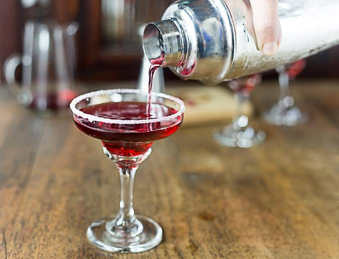 My Valentines Day favorite cocktail: Pomegranate Margarita. Sweet, tangy, light and refreshing pomegranate margarita with a sugar rimmed glass adds a nice contrast of flavors. | ethnicspoon.com