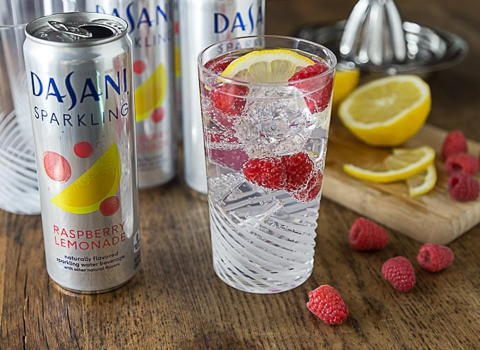 Try a refreshing sparkling berry lemony spritz! Mix up a nice mocktail with some Dasani Sparkling, fresh lemon juice and toss in a few raspberries too! #CollectiveBias #NewWayToSparkle #ad| ethnicspoon.com