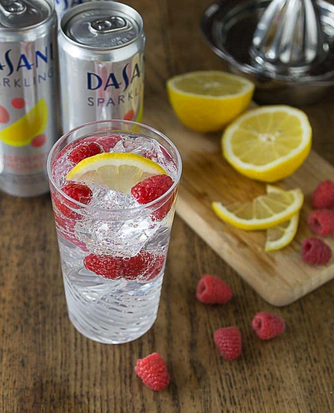 Crisp and REFRESHING! Dasani Sparkling with some fresh lemon juice and a few raspberries make a great summer cooler! #CollectiveBias #NewWayToSparkle #ad | ethnicspoon.com