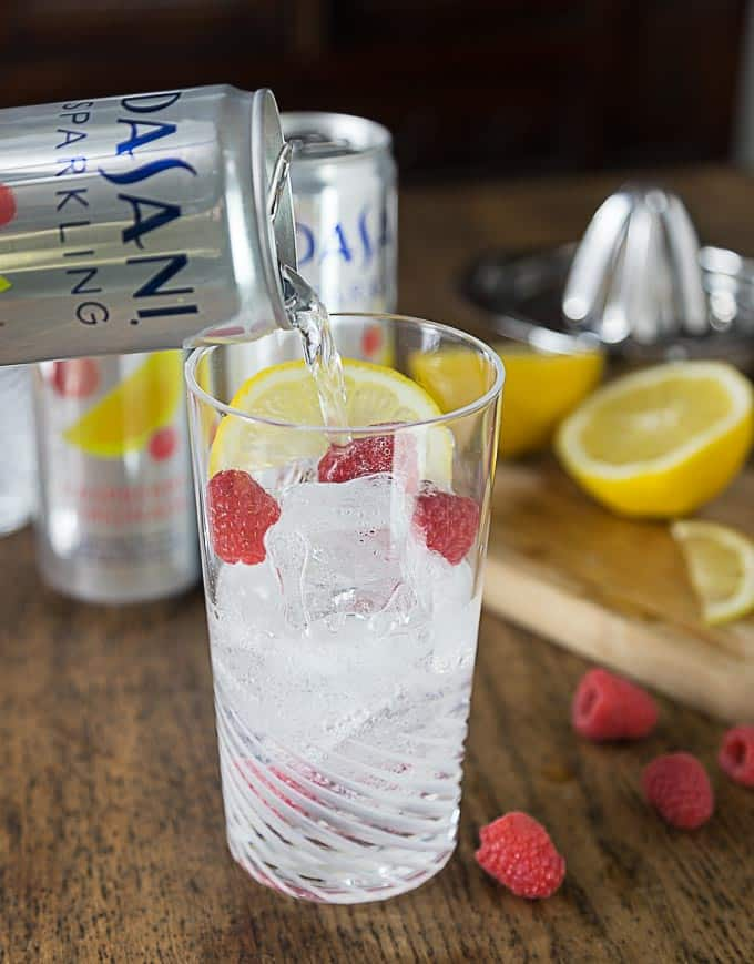 Cool off with a sparkling berry lemony spritz! Dasani Sparkling with some fresh lemon juice and a few raspberries make a great summer cooler! #CollectiveBias #NewWayToSparkle #ad | ethnicspoon.com