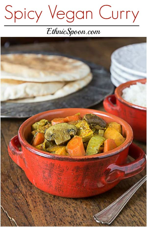 Love curry? You will love the this nice spicy vegan curry! This recipe has a nice blend of sweet and heat with mushrooms, tofu, carrots, sweet potato, garam masala, ginger and cayenne. | ethnicspoon.com