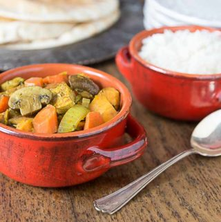 Try a nice spicy vegan curry! This recipe has a nice blend of sweet and heat with mushrooms, tofu, carrots, sweet potato, garam masala, ginger and cayenne. | ethnicspoon.com