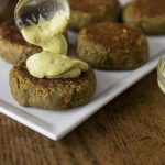 Try a healthy burger with amazing flavors! Spicy curry lentil burgers with a creamy rich avocado yogurt sauce kicked up with a little chili powder. #vegetarian | ethnicspoon.com