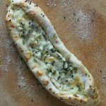 Pide: A savory Turkish bread baked with a variety of ingredients. Try some feta, mozzarella, and parsley. You can add tomato, spinach, egg or ground seasoned lamb if you like. | ethnicspoon.com
