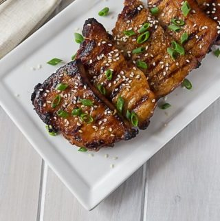 Tender boneless pork chops in a spicy Korean style BBQ sauce! A quick and easy weeknight meal. | ethnicspoon.com