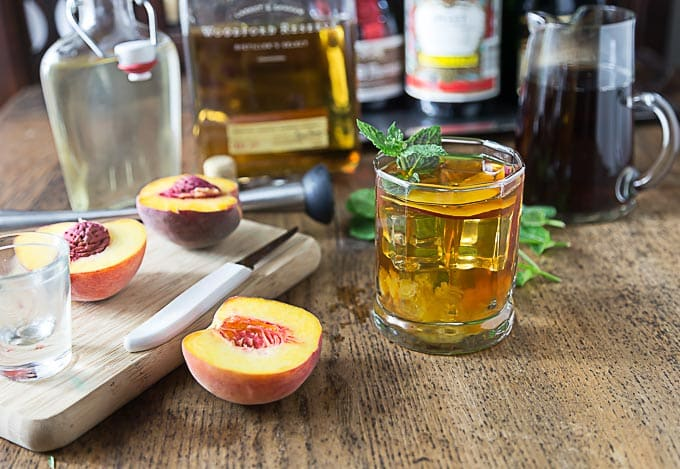 Refresh on a hot summer day with a bourbon peach tea smash. I love local peaches in this is a delicious cocktail! | ethnicspoon.com