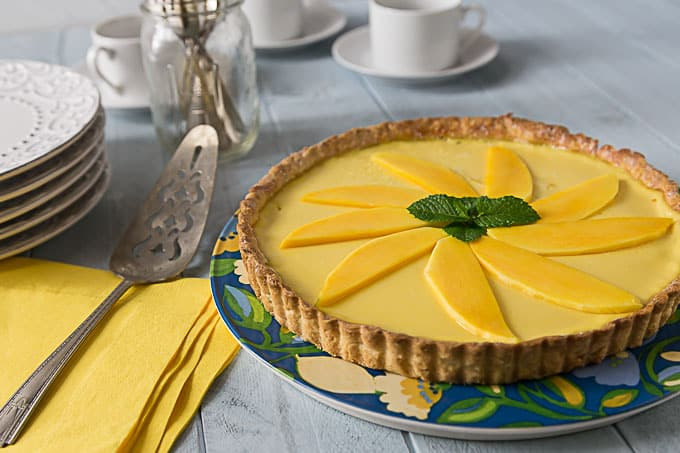 Mango passion fruit tart! 4 words you will not forget and will love this tart! Sweet, creamy and tangy are all the wonderful tropical flavors that will delight you! Baked in a nice sweet crunchy shortcrust. | ethnicspoon.com
