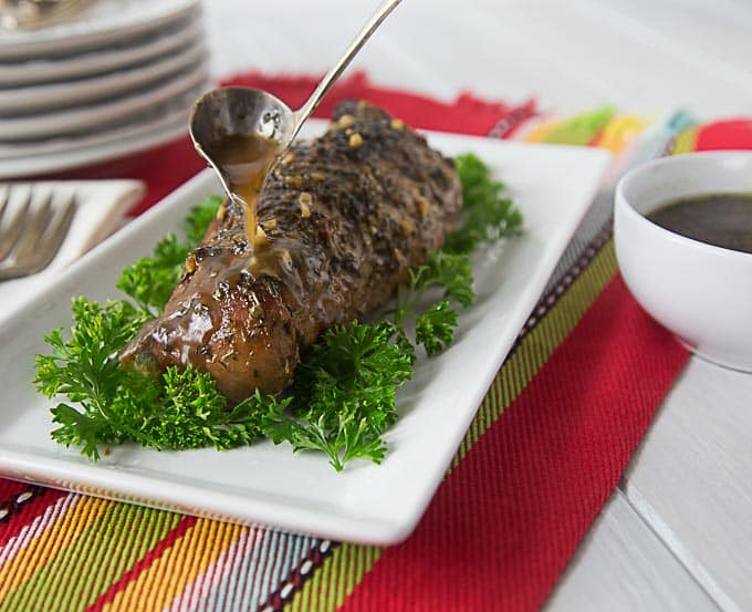 Marinated tropical style pork loin in tamarind sauce with garlic and herbs. Melt in your mouth tender with sweet and delicate flavors. | ethnicspoon.com
