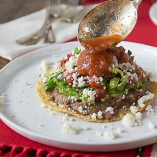 Refried Beans, Avocado, Tomato, Queso Fresco Tostada