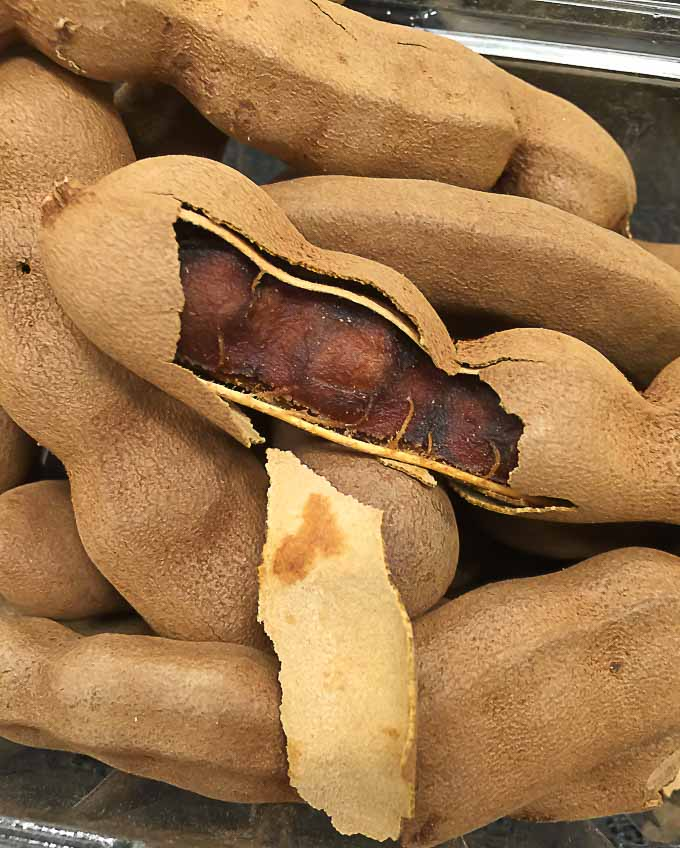 fresh tamarind with one broken seedpod