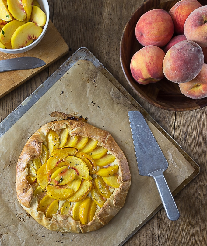 How I love peach season! Fresh peach crostata with a creamy Neufchatel filling! It one of my favorite farm to table desserts! | ethnicspoon.com