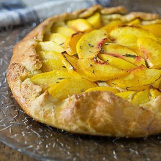 A rustic dessert that is simple to make! Fresh peach crostata with a creamy Neufchatel filling! It one of my favorite farm to table desserts! | ethnicspoon.com