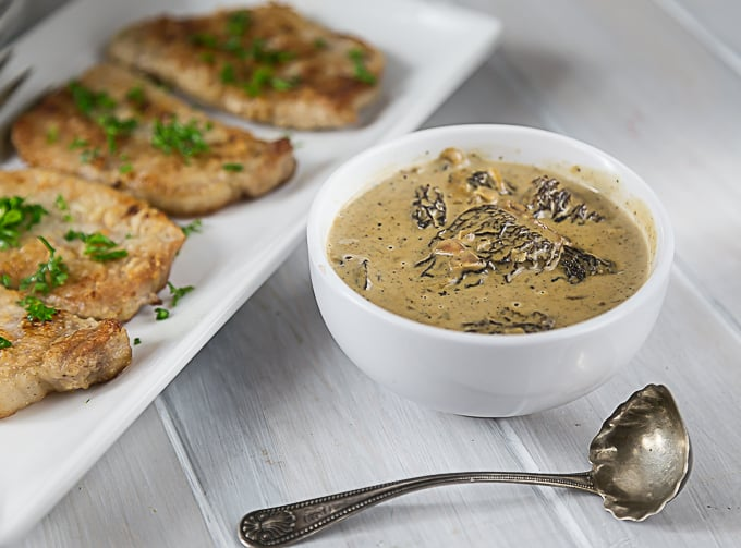 Pork chops in a sweet, creamy morel mushroom sauce. A simple pan sauce brings an exotic meal to the table in less than 30 minutes. | ethnicspoon.com