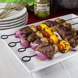 Enjoy some juicy tender beef kebabs with a Latin twist! Marinated in HERDEZ® Salsa Verde, garlic, nutmeg, salt & oregano. | ethnicspoon.com
