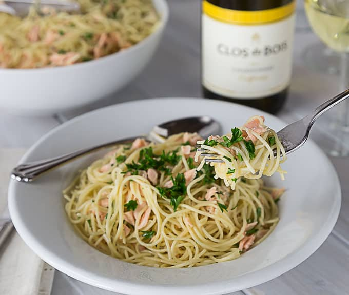 A rich creamy sauce with salmon, dill and angel hair pasta with a little cayenne kick! This pasta is AMAZING! A super simple weeknight meal too! So Good! | ethnicspoon.com