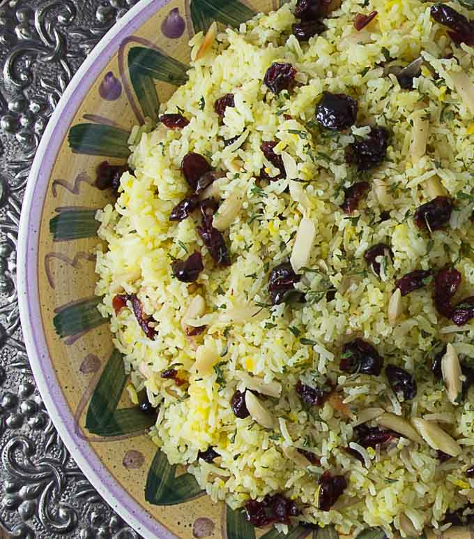 a plate of Persian saffron rice with craisins and almonds