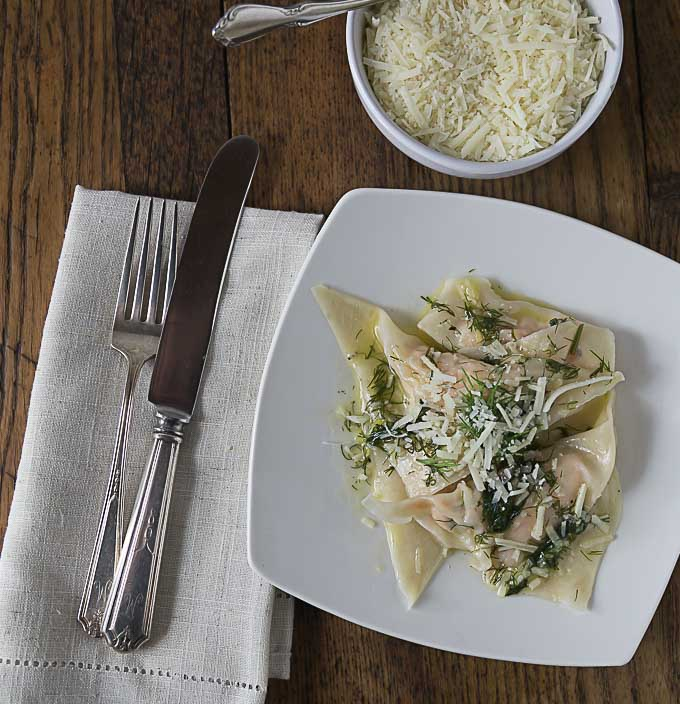 Quick and easy salmon ravioli made with wonton wrappers. You'll love this time saving recipe and serve it with a simple lemon dill white wine sauce. | ethnicspoon.com
