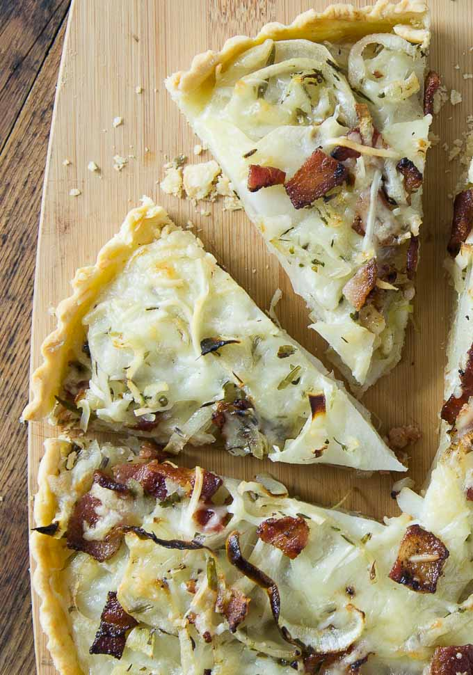 A close up of slices of potato bacon gruyere tart.