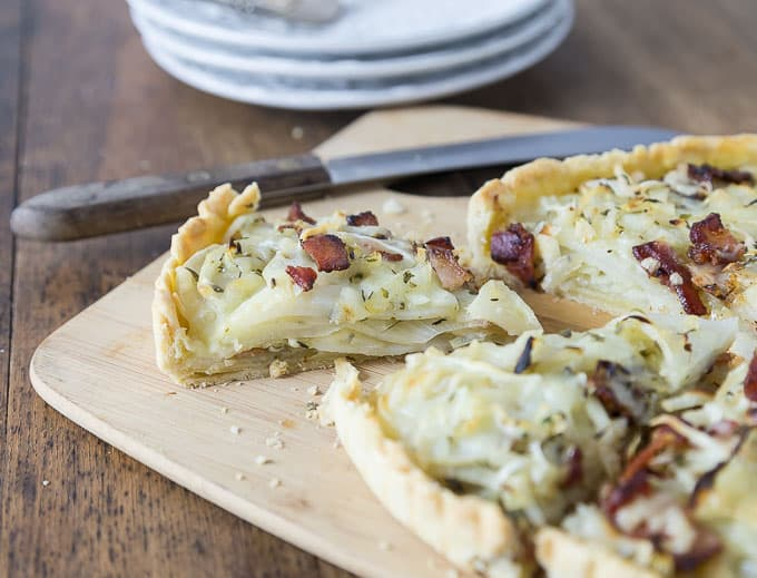 Bacon lovers will love this! You'll love this tasty potato, bacon & gruyere tart! A lovely savory cheesy tart with sweet onions, salty bacon and a nice hint of herbs with my own special blend of herbes de provence. | ethnicspoon.com