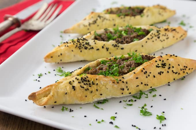 Here is a fun dish to try! Try a simple and exotic Lebanese lamb fatayer with a simple dough and an incredible spice mixture. This is a Lebanese version of a calzone and will be a family favorite and fun to make too! | ethnicspoon.com