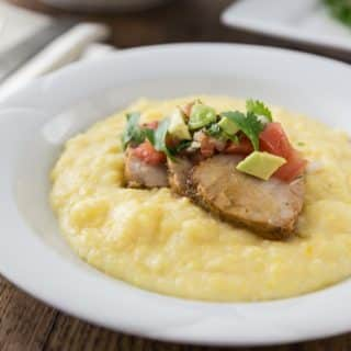 Roasted Garlic and Herb Pork Loin Over Cheesy Grits