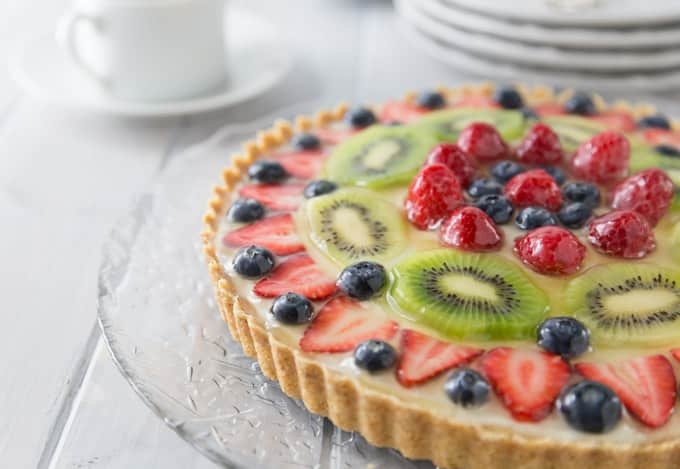 The best fruit tart I have ever made! This has a creamy vanilla filling with a nice crunchy shortbread crust topped off with fresh fruit! Delicious! You are going to love the French patisserie style tart! It's so simple to make, bake the shortbread crust, whip together the filling and add to the crust and add the fruit. | ethnicspoon.com
