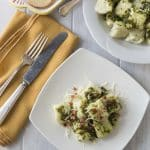 Love Italian food? Try this creamy and rich ricotta gnocchi with a nice lemony arugula pesto and tasty salty bits of pancetta! Everything is better with bacon right? The texture of the gnocchi has a nice firm outside and soft cheesy middle. This is a must try recipe. Buon appetito! | ethnicspoon.com