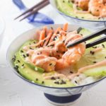 No time to roll your own sushi? Healthy and easy to make spicy shrimp sushi bowls with avocado, carrots, nori, sticky rice, cucumber slices and sprinkled with black sesame. Top this off with a spicy sriracha sour cream sauce! Dip in some tasty soy sauce and enjoy. | ethnicspoon.com