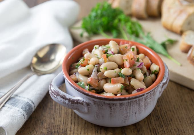 Here is a must try: cannellini bean,, parsley, tomato red onion salad when you want to eat something cool or take to a picnic. The flavors are fantastic with fresh parsley and tarragon for nice herbal note. | ethnicspoon.com