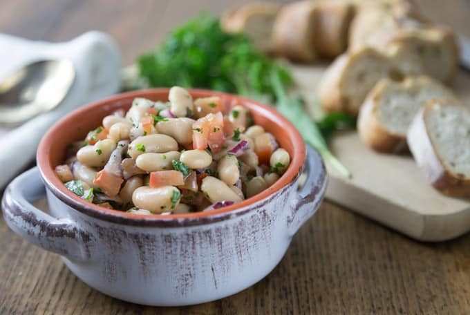 Quick and easy! Here is a must try cannellini bean, parsley, tomato, red onion salad when you want to eat something cool or take to a picnic. The flavors are fantastic with fresh parsley and tarragon for nice herbal note. | ethnicspoon.com