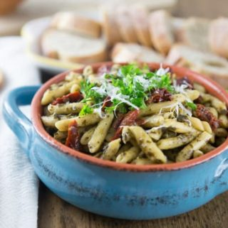 a blue bowl of penne pasta
