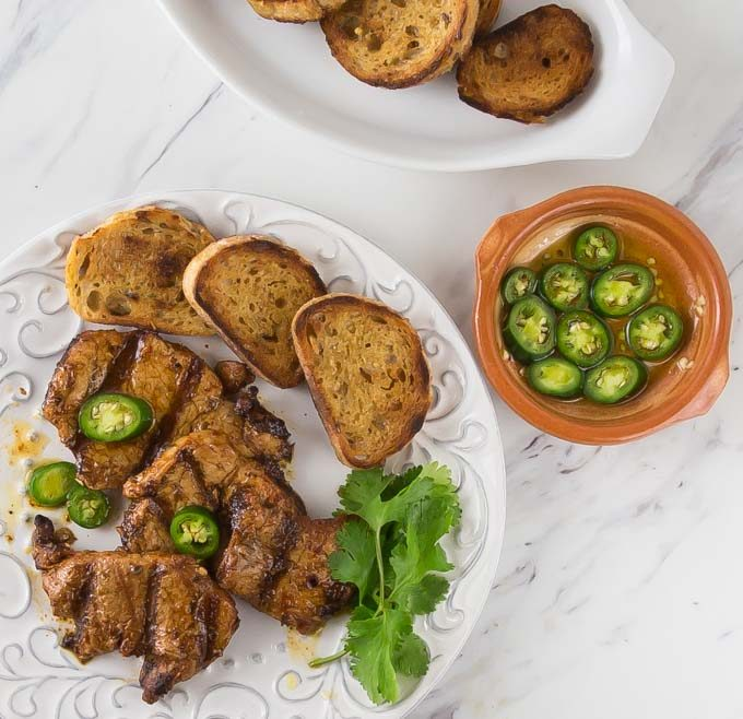 Here is a must try for your next party and grilling event! How about a classic Spanish tapas dish! Spicy marinated pork tenderloin medallions in paprika marinade and flash grilled al la plancha or al carbon. | ethnicspoon.com