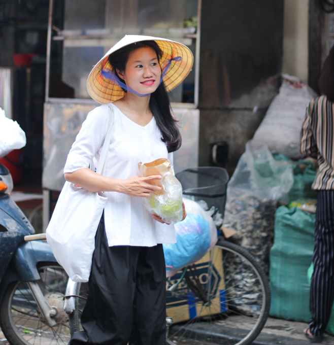 Thanh shopping in the market in Hanoi