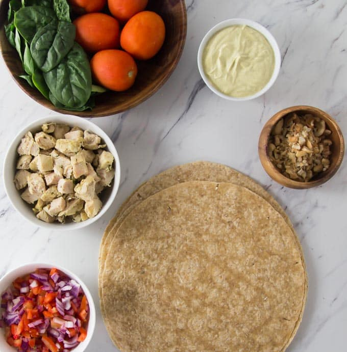 chicken curry wrap ingredients on a table