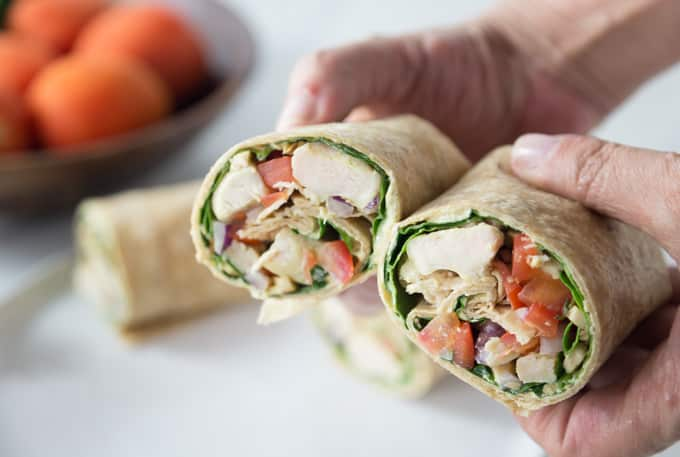 Bring some exotic flavors to your next meal or appetizer dish. Creamy and spicy curry chicken salad wraps add a bit of ethnic flair to your lunch or dinner. You can also slice these narrow and serve as an appetizer too! The secret sauce: a bit of my homemade curry blend whipped into some Greek yogurt. This is a really healthy recipe wrapped in a large flour tortilla! | ethnicspoon.com