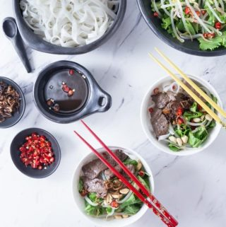 Vietnamese Beef Noodle Salad (Phở Trộn) is a delicious recipe for noodle salad for the hot summers in Hanoi or anywhere when you need a cool dish for lunch or dinner. This has some of the best authentic Vietnamese contrast of flavors: salty, tangy, sweet, butter and some hot chillies for some heat too! | ethnicspoon.com