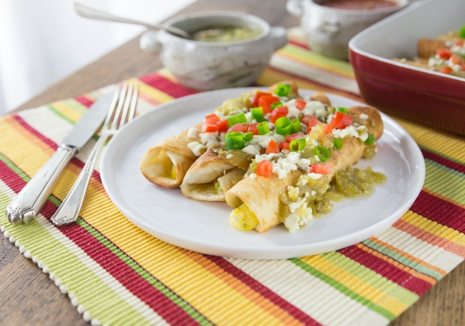 Hola everyone! Today's recipe is three cheese Mexican flautas with some spicy salsa verde. I like to drop my Mexican three cheese flautas in a hot pan with a little oil to give them a nice color and then I bake them with salsa verde and some queso fresco on top. I love Mexican food! This recipe is so easy to make too! | ethnicspoon.com